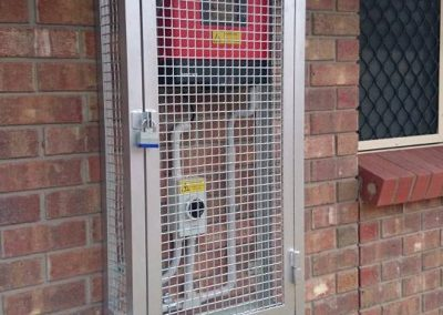 Cage installation for hot water system protection in South Australia